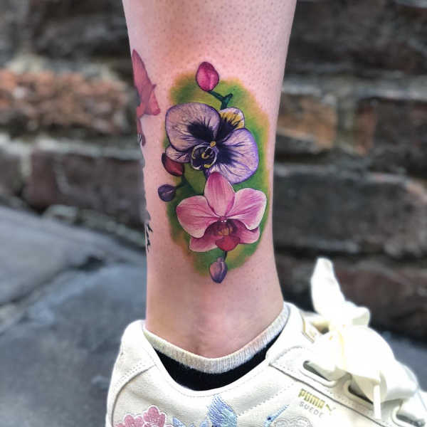 Tatuaże kwiaty Znaczenie tatuaży  Tatuaż storczyk – znaczenie, historia, 50 zdjęć
